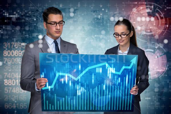 Stock fotó: üzletemberek · megbeszél · stock · diagram · trendek · nő
