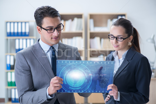 Businessman and businesswoman discussing trading strategies Stock photo © Elnur