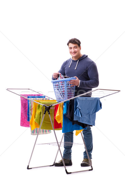 Husband man doing laundry isolated on white Stock photo © Elnur
