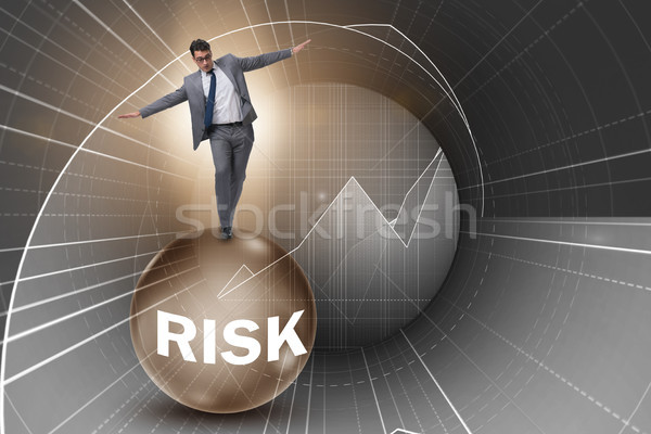 Young businessman in business risk and uncertainty concept Stock photo © Elnur