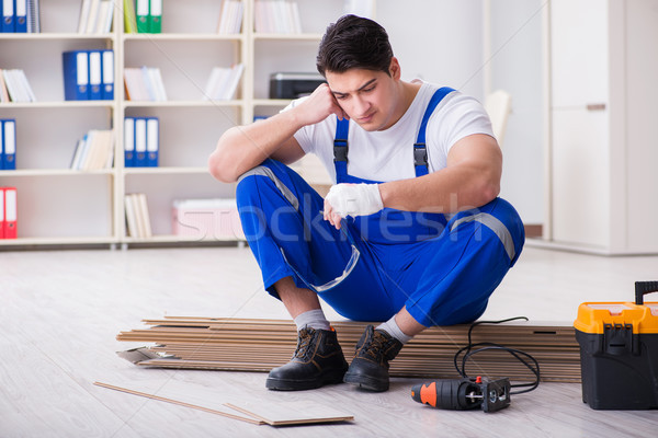 Young worker working on floor laminate tiles Stock photo © Elnur