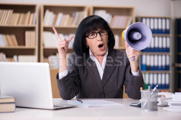 Angry businesswoman shouting with loudspeaker Stock photo © Elnur