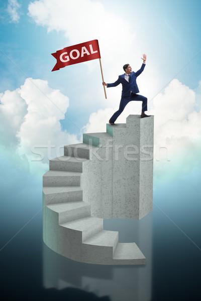 Businessman achieving his business goal objective Stock photo © Elnur