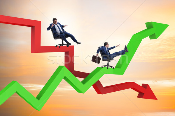 Growth and decline concept with businessmen Stock photo © Elnur