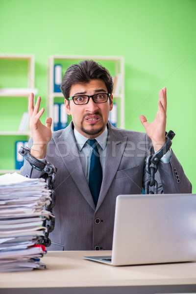 Employee chained to his desk due to workload Stock photo © Elnur