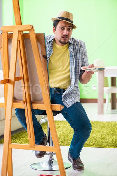 Jovem masculino artista trabalhando novo pintura Foto stock © Elnur