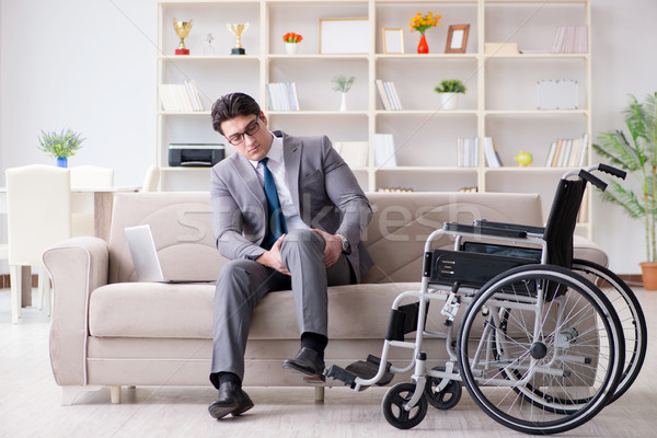 Dsabled businessman on wheelchair working home Stock photo © Elnur