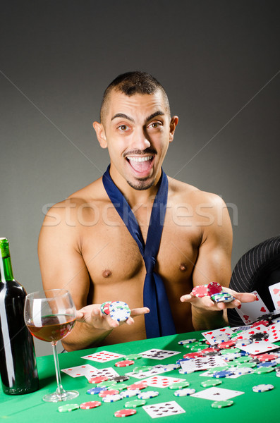 Man drinking and playing in casino Stock photo © Elnur