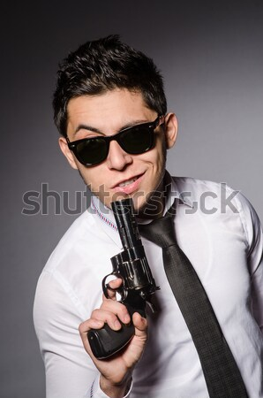 Man wearing sunglasses with gun Stock photo © Elnur