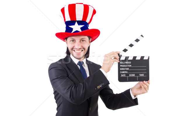 Stock photo: Man with USA hat and movie board isolated on white