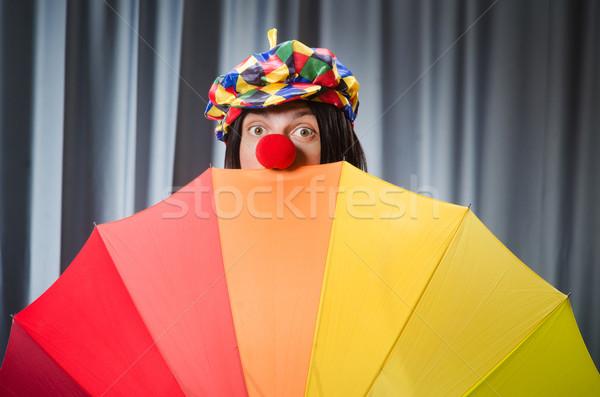 Stockfoto: Grappig · clown · kleurrijk · paraplu · glimlach · man