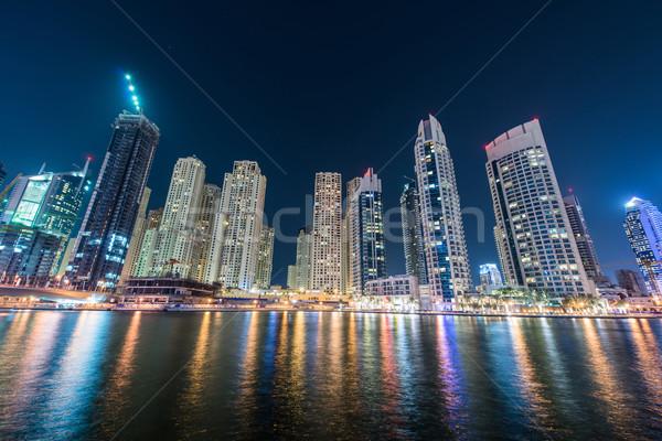 Stockfoto: Dubai · jachthaven · wolkenkrabbers · nacht · hemel · water