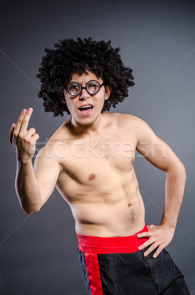 Funny sportsman sporting his muscles Stock photo © Elnur