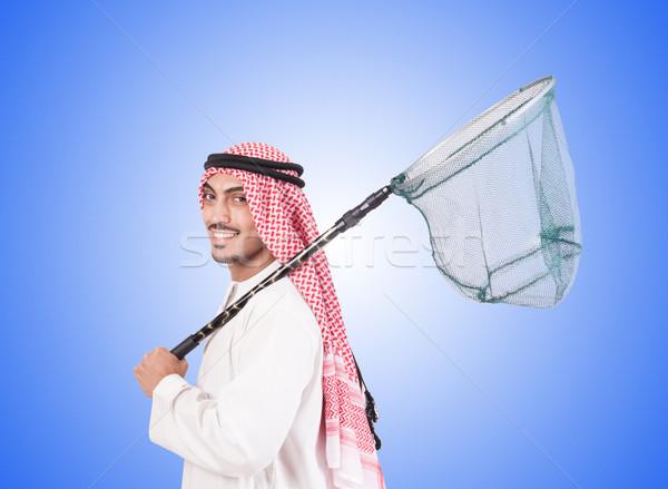 Arab businessman with catching net against gradient  Stock photo © Elnur