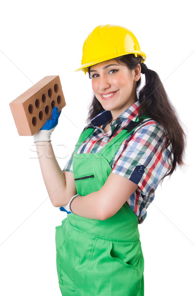 Female workman in green overalls holding brick isolated on white Stock photo © Elnur