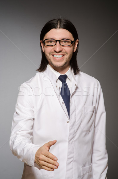 Young physician against gray Stock photo © Elnur