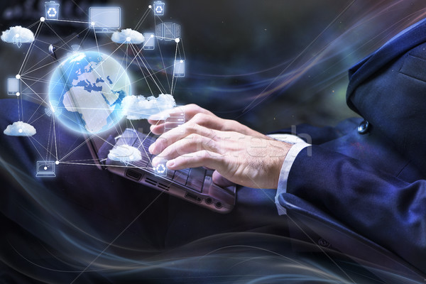 Businessman working with laptop in cloud computing concept Stock photo © Elnur