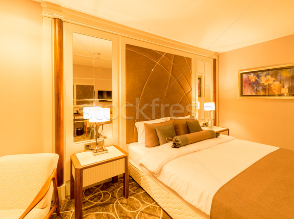 Modern hotel room with big bed Stock photo © Elnur