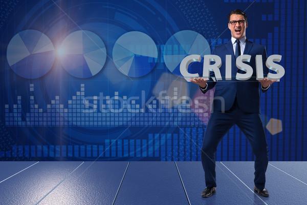 Businessman in crisis business concept Stock photo © Elnur