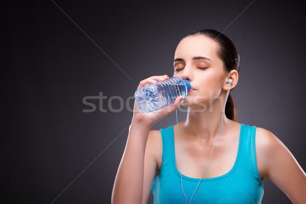 Mulher esportes garrafa água doce água música Foto stock © Elnur