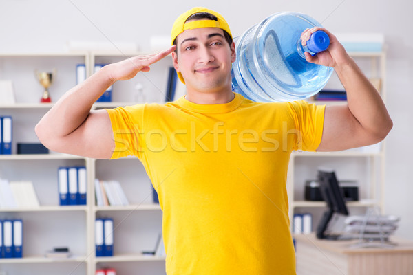 The man delivering water bottle to the office Stock photo © Elnur