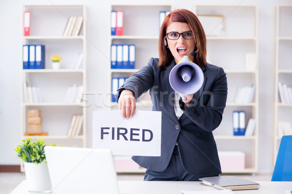 Businesswoman firing people in office Stock photo © Elnur