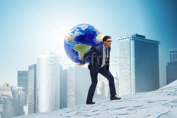 Businessman carrying Earth on his shoulders Stock photo © Elnur
