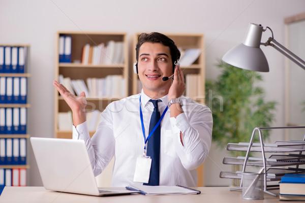 Handsome customer service clerk with headset  Stock photo © Elnur