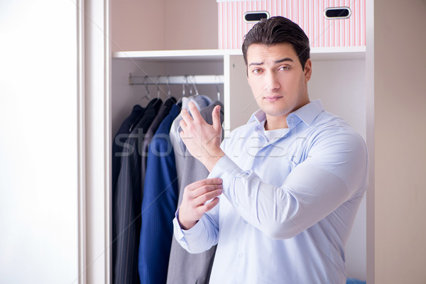 Young man businessman getting dressed for work Stock photo © Elnur