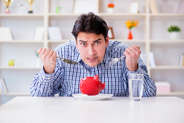 Man running out of money in restaurant and using savings from pi Stock photo © Elnur
