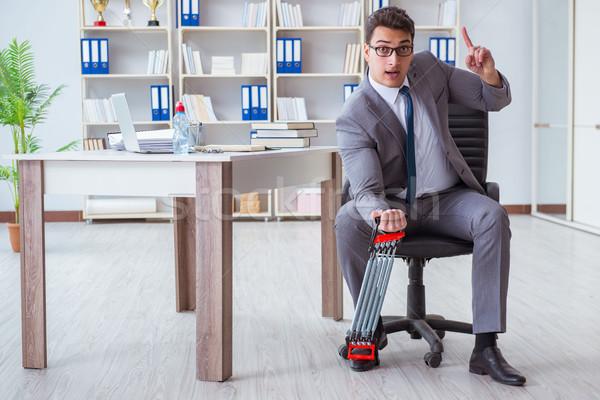 Fiatal üzletember testmozgás rugalmas iroda férfi Stock fotó © Elnur