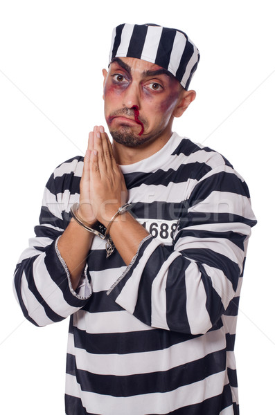 Badly bruised prisoner with handcuffs Stock photo © Elnur