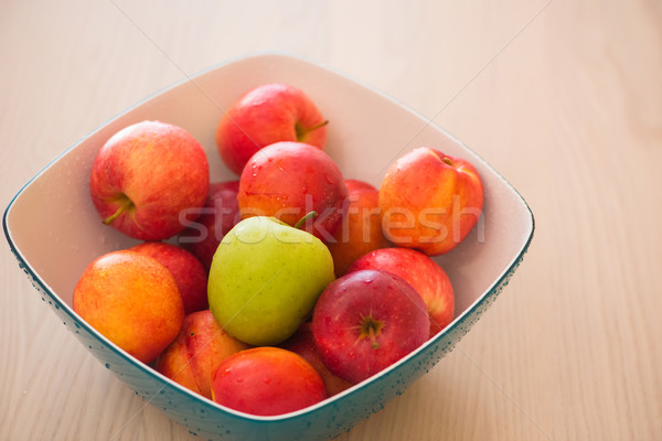 Stock photo: Fruits in the bown on table