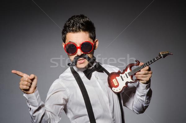 面白い 男 ミニ ギター パーティ 背景 ストックフォト © Elnur