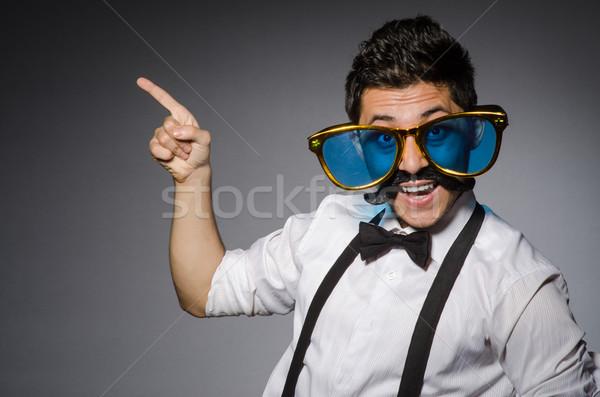 Jeune homme faux moustache lunettes de soleil isolé Photo stock © Elnur