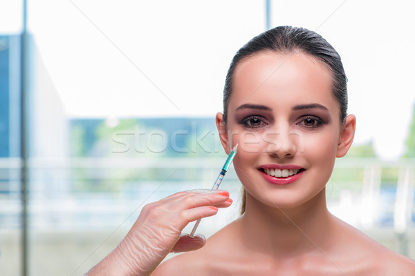 Beautiful woman preparing for botox injection Stock photo © Elnur