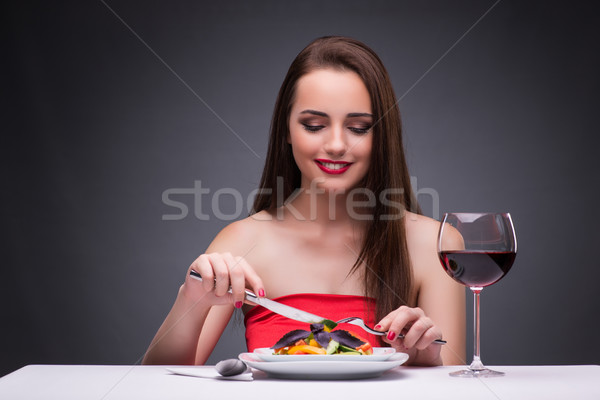 The beautiful woman eating alone with wine Stock photo © Elnur