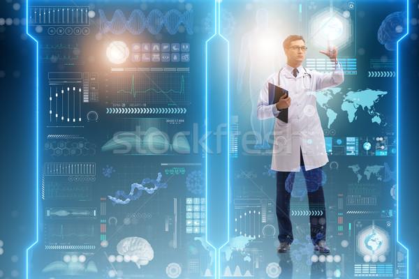 The doctor in futuristic medical concept pressing button Stock photo © Elnur