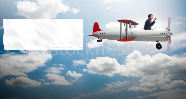 Kétfedelű repülőgép üzletember szalag égbolt papír keret Stock fotó © Elnur