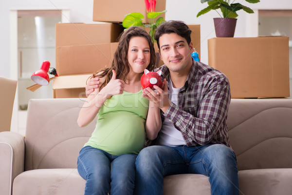 The young couple saving money for baby to be born Stock photo © Elnur