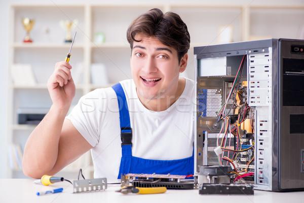 Computer repairman repairing desktop computer Stock photo © Elnur