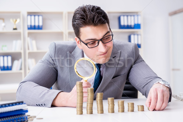 Businessman with golden coins in business growth concept Stock photo © Elnur