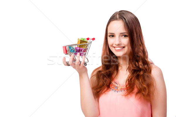 Young woman with shopping cart isolated on white Stock photo © Elnur