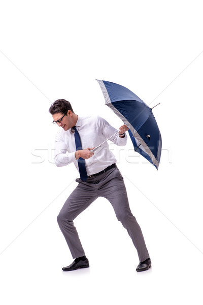Young businessman with umbrella isolated on white Stock photo © Elnur