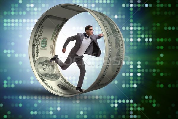 üzletember kaméleon kerék dollár férfi testmozgás Stock fotó © Elnur