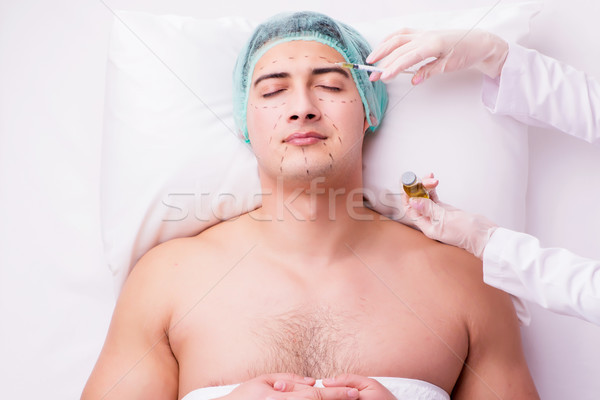 The handsome man in spa massage concept Stock photo © Elnur