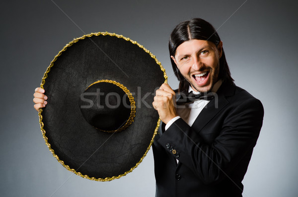 Young mexican man wearing sombrero Stock photo © Elnur