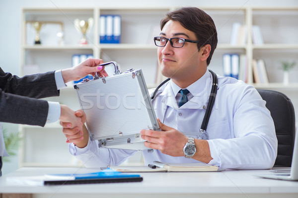 Young doctor in medical insurance fraud concept Stock photo © Elnur