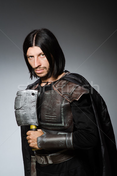 Knight with axe against dark background Stock photo © Elnur