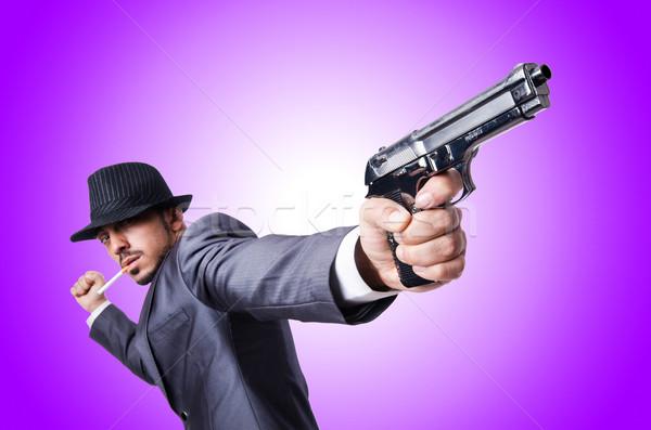 üzletember fegyver izolált fehér kéz férfi Stock fotó © Elnur